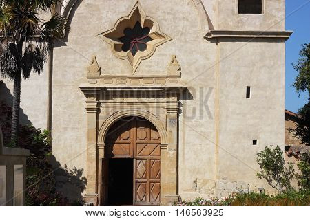 This is an image of the main door open at the Carmel Mission in Carmel, California, U.S.A.