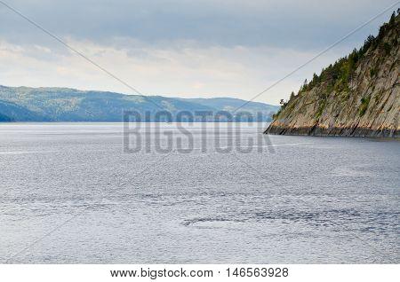 Saguenay river under gray dark clouds.Quebec, Canada.