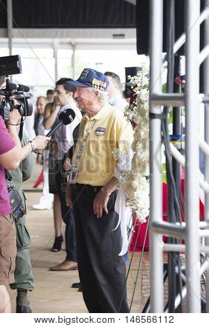 NEW YORK MAY 30 2016: A US veteran and staff member from the Intrepid, speaks to the media at the Memorial Day Observance service on the Intrepid Sea, Air & Space Museum during Fleet Week NY 2016.