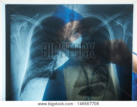 Doctor Behind X-ray Image