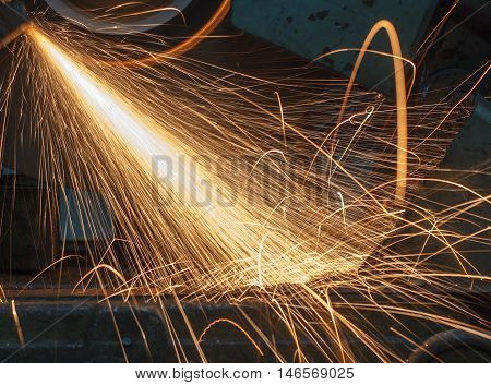 The machinery spark with welding metal industrial.