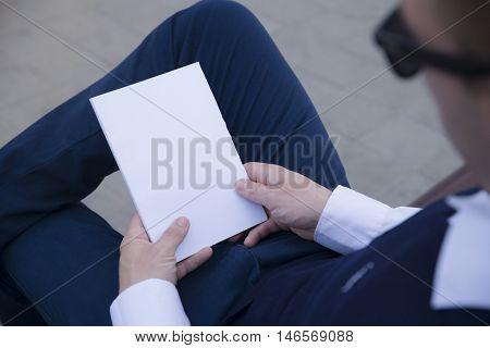 Mockup cover magazine, catalog, book. Man reading a blank magazine, catalog, book.