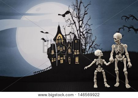 Skeleton and little skeleton walking in the night with Halloween background