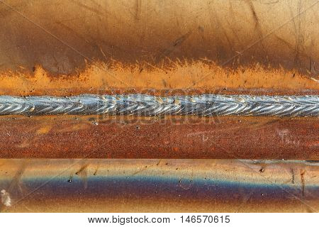 welding seam onto steel sheet metal Industrial steel welder in factory