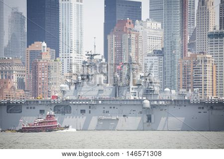 JERSEY CITY NJ - MAY 31 2016: USS Bataan (LHD 5) on the Hudson River passes Lower Manhattan upon departing Manhattan marking the end of Fleet Week 2016 as seen from Liberty State Park.