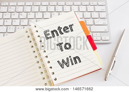 Word text Enter to win on white paper card on office table / business concept