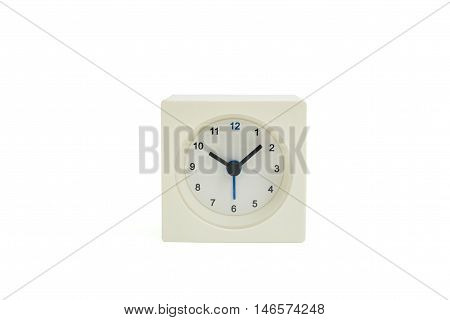 Isolated white square alarm clock at ten o'clock on white background