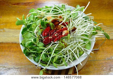 raw sunflower sprout dressing oyster sauce and chili prepare to cook