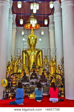 Three Ladies In Front Of Buddha Image At Buddha Church