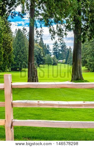 Golf course with wooden fence
