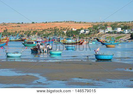 MUI NE, VIETNAM - DECEMBER 25, 2015: Fishing harbor. The fishing harbor of Mui Ne village in the early morning