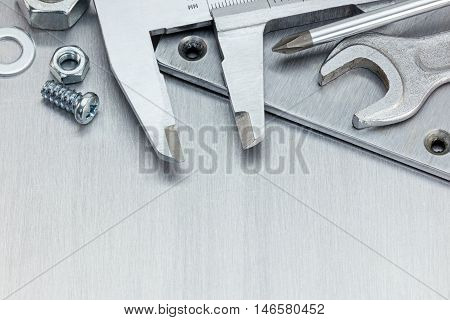 Vernier Caliper, Wrench And Other Working Tools For Repair On Scratched Metal Background