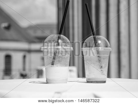 Cocktail Glasses On A Table In Black And White