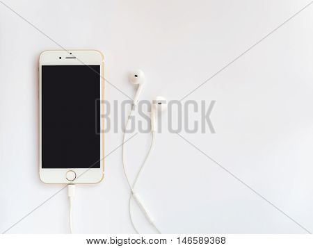 CHINGRAI THAILAND -SEPTEMBER 9 2016: Front view image of new Apple iPhone7 mockup and new Apple EarPods mockup on white background.