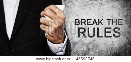 Businessman fist squeeze paper on concrete texture with