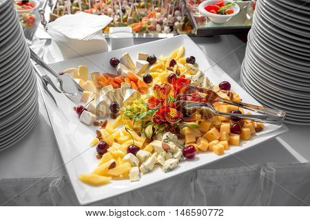 Banquet Table in restaurant served with different meals. Ready for wedding reception.