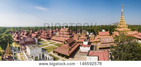 Replica of Mandalay Royal Palace build in 1990s. Original palace was destroyed in WWII. Mandalay, Myanmar. Panoramic photo