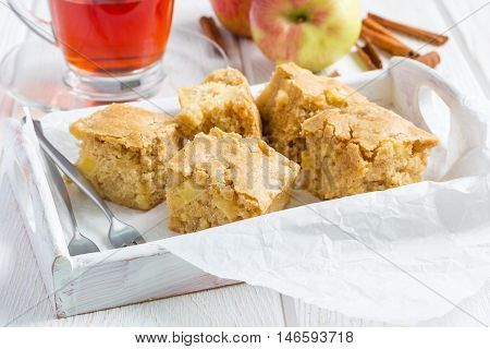 Homemade blondie (blonde) brownies apple cake square slices in wooden tray horizontal