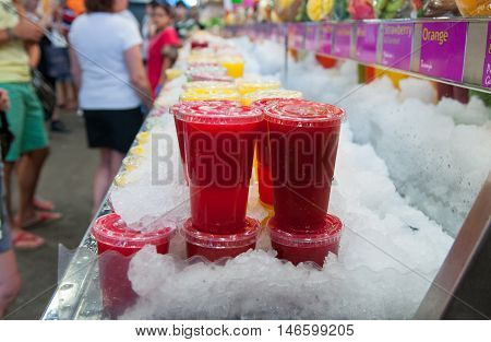 The fresh red  juice on ice  at La Boqueria market in Barcelona. Spain