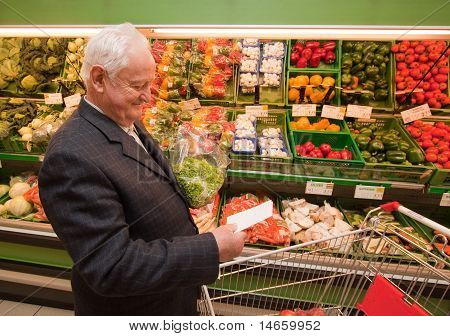 Senior shopping for food in Supermar