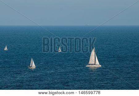 Sail boats at Barselona bay. Catalunia. Spain
