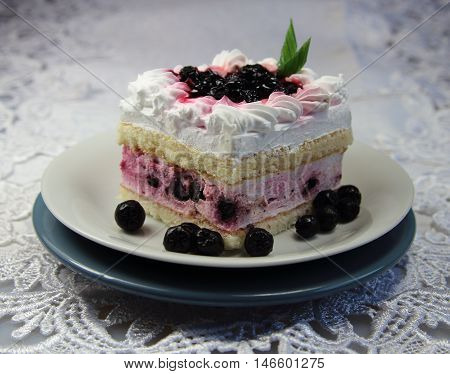 cake with whipped cream and wild berries