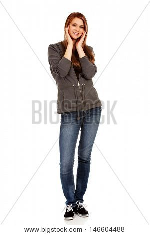 Teenage happy woman holding both hands on cheeks