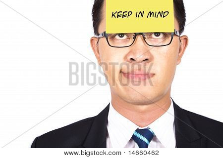Remember and keep in mind.businessman helpless watching the post it