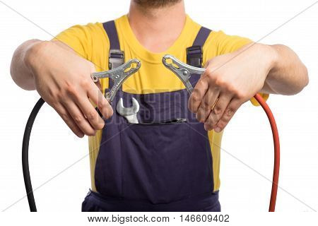Confidence mechanic holding car jumper cables with yellow t-shirt