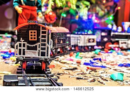 Christmas Toy Railroad Near A Christmas Tree With Lights