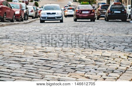 cars go on the road a cobbles.