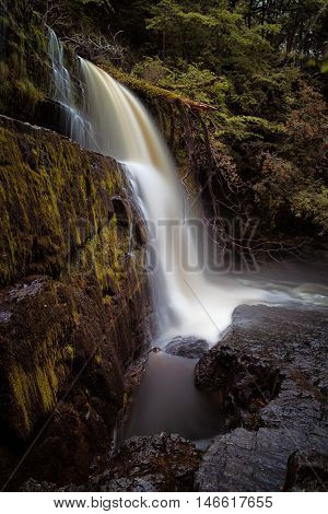 The ledge at Sgwd Clun Gwyn Huge ledged waterfall on the Mellte river, near Pontneddfechan in South Wales, UK.