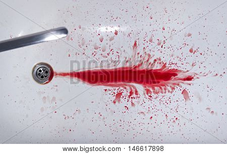 A drop of blood in the bath and faucet