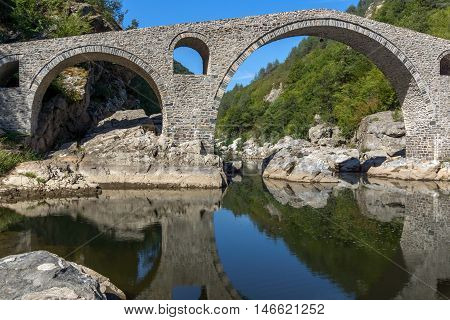 Amazing Reflection of Devil's Bridge in Arda river, Kardzhali Region, Bulgaria