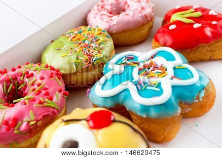 Six delicious and colorful donuts in box
