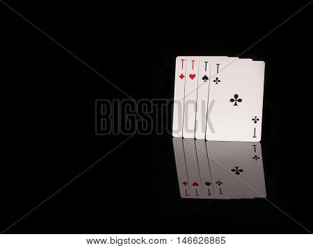 Four aces isolated on black background . casino concept