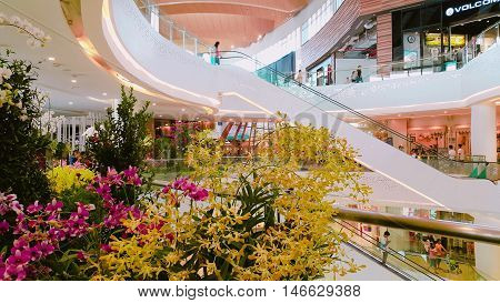 Thailand - September 4, 2016 : The interior modern mall ZPELL FUTURE PARK MALL. There are decorated flowers interior seasoning.