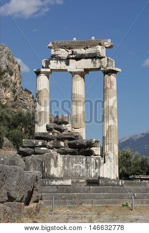 the ruins of the ancient temple of Athena in Delphi located in the mountains Sunny day summer Greece