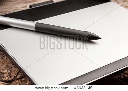 Graphic tablet with pen close-up shoot. Graphic tablet with stylus illustration.