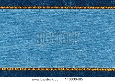 Fashionable background denim and yellow rhinestones with space for your text
