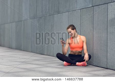 Fit Young Woman Sitting Checking Her Mobile