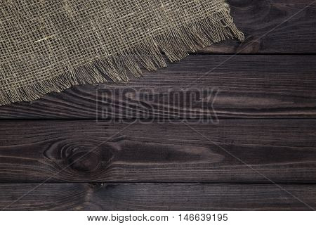 Burlap texture on wooden table background. Wooden table with sacking
