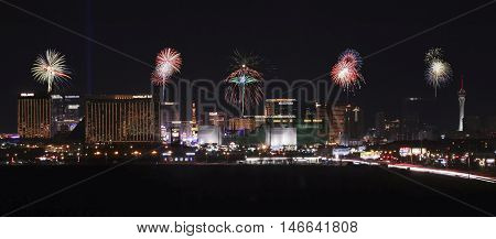 LAS VEGAS, NEVADA, July 4. Las Vegas Boulevard on July 4, 2016, in Las Vegas, Nevada. A view of the south end of Las Vegas Boulevard looking north at night with fireworks in Las Vegas Nevada.