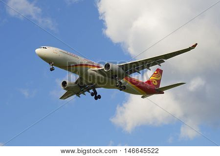 SAINT PETERSBURG, RUSSIA - JULY 24, 2015: The Airbus A330-343 (B-5910) airlines Hainan Airlines in flight