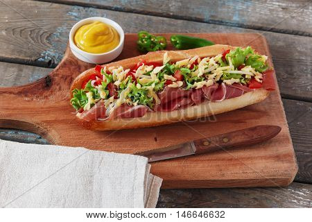 sandwich baguette ham jamon cheese with tomato and herbs