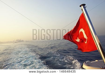 Flag of Turkey on a boat in Bosphorus strait Istanbul Turkey