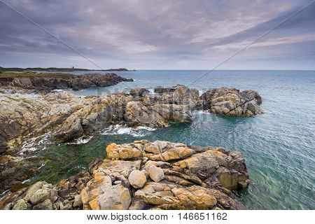 Rocky shore of the coast of the Island of Guernsey, Channel Islands, UK