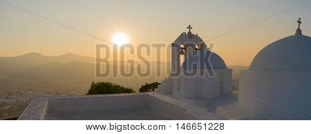 Saint Antony church against the sunset panoramic view at Paros island in Greece.