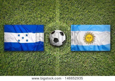 Honduras Vs. Argentina Flags On Soccer Field, 3D Illustration