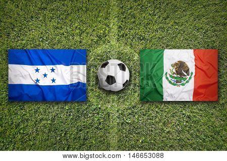 Honduras Vs. Mexico Flags On Soccer Field, 3D Illustration